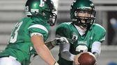 Farmingdale Vinny Quinn (right) hands off to teammate