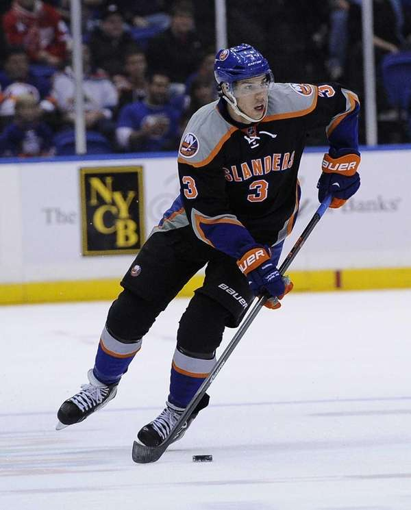 Travis Hamonic skates against the Detroit Red Wings