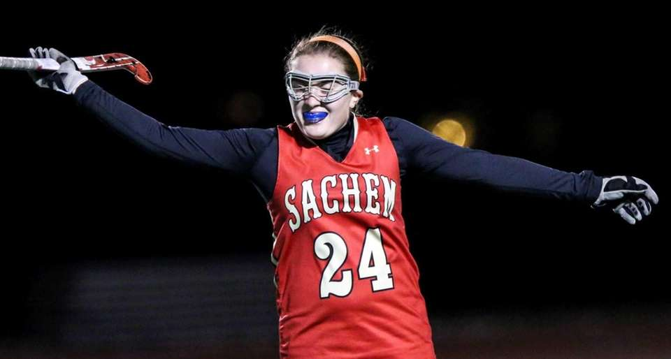 Sachem East's Jessica D'angelo (24) celebrates after defeating