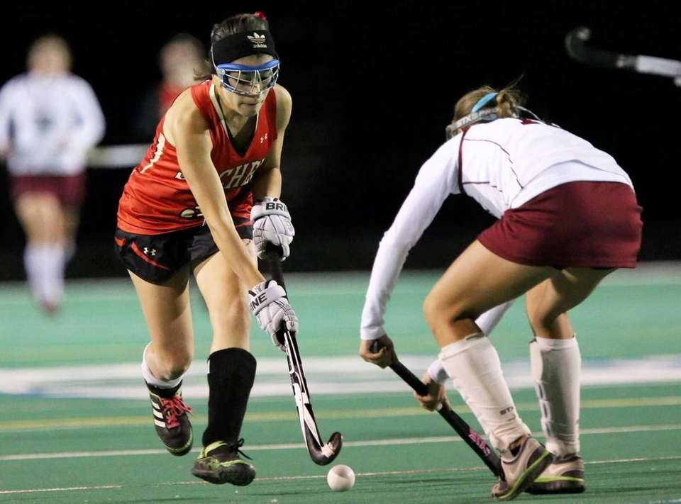 Sachem East's Taylor Giordano moves the ball around