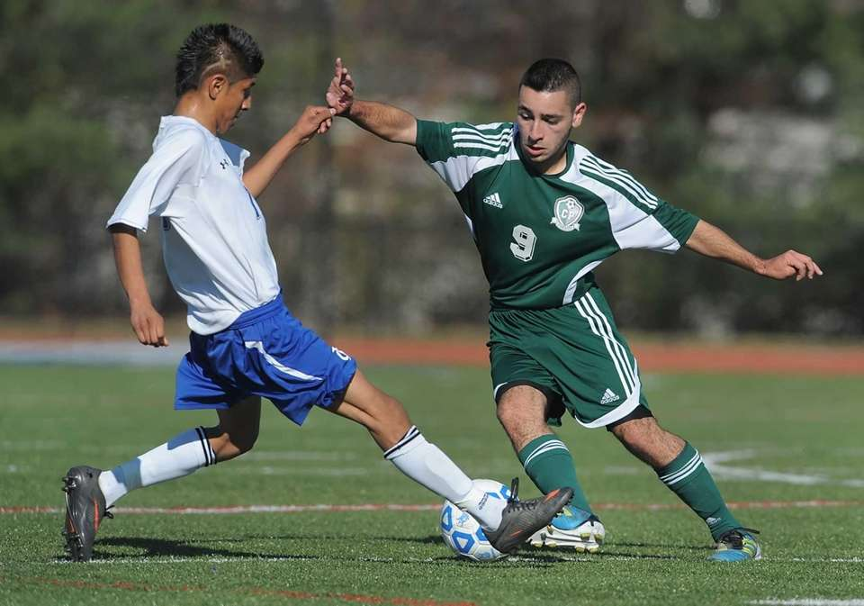 Carle Place's Francesco Irace, right, turns the ball