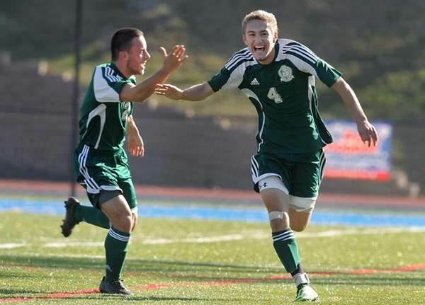 Carle Place's Dylan Klein, right, celebrates his goal