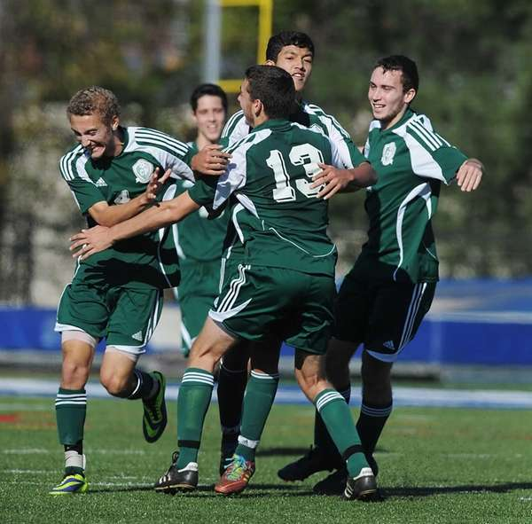 Carle Place players celebrate their third goal of
