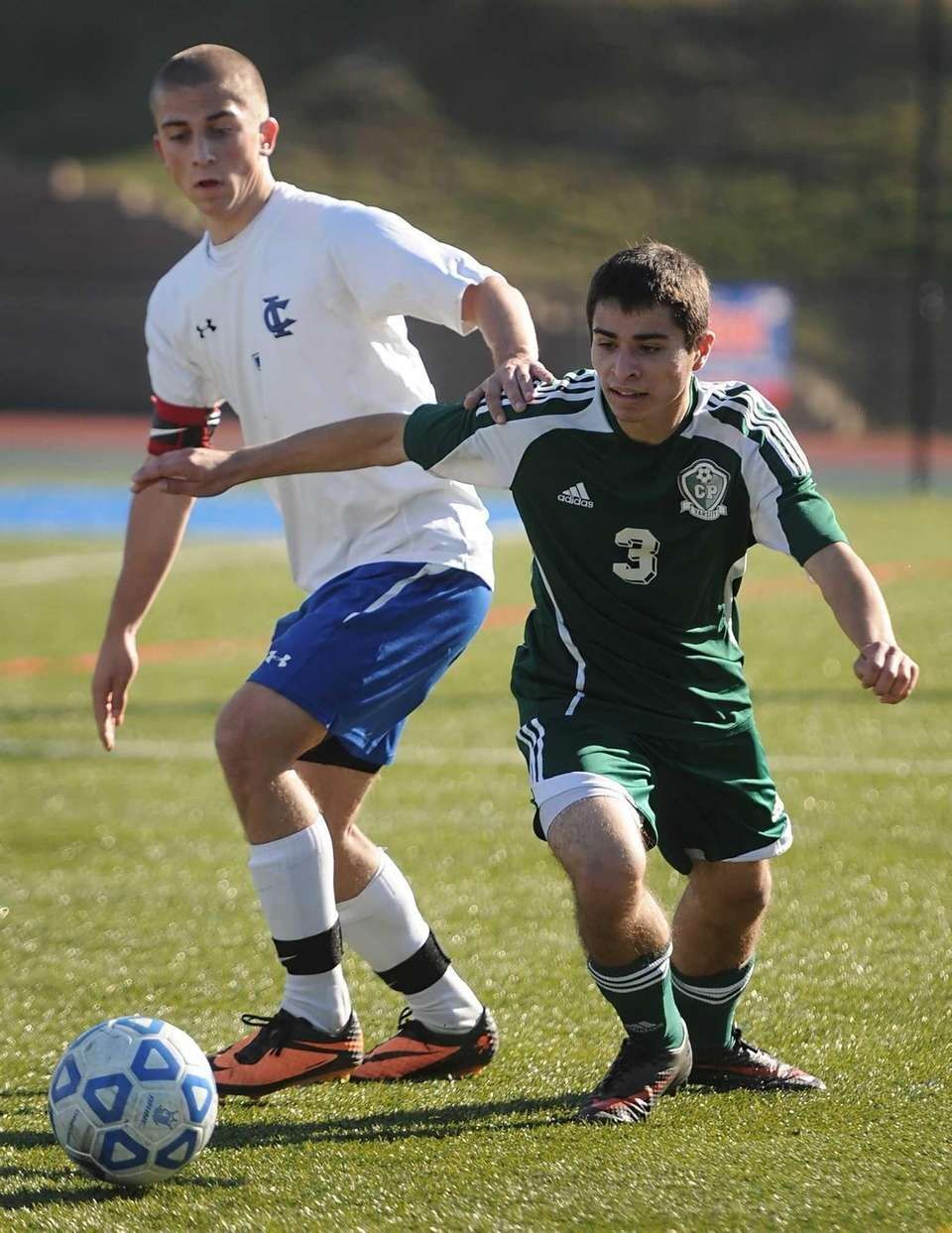 Carle Place's George Costidis, right, dribbles the ball