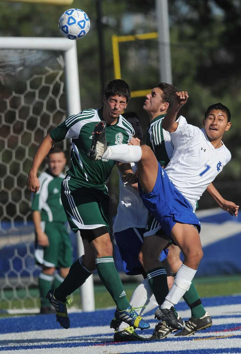 Carle Place's Roberto Posillico, left, clears the ball