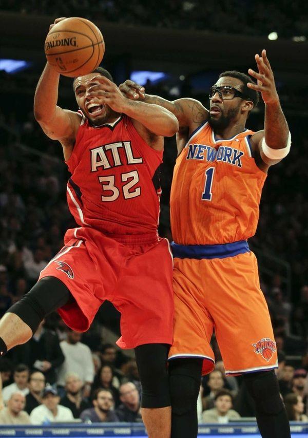 Knicks power forward Amar'e Stoudemire fouls Atlanta Hawks