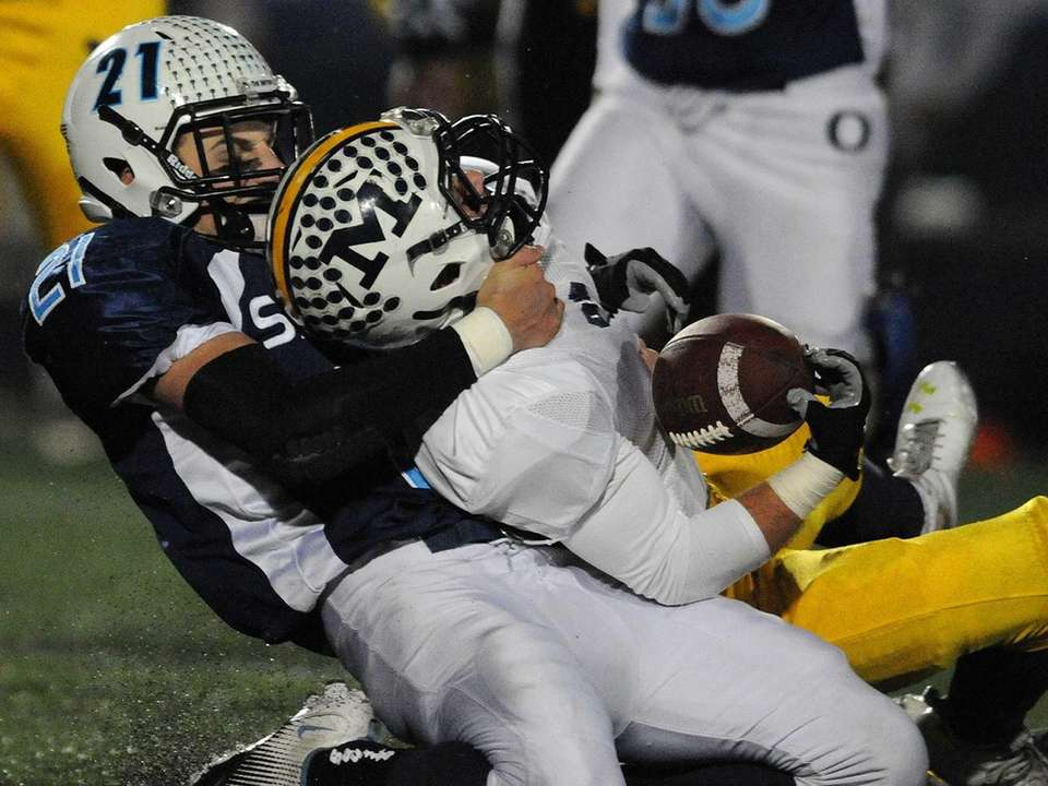 Massapequa's Jack Korber, right, fights for yards as