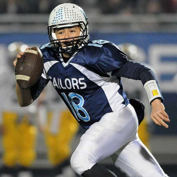 Oceanside quarterback Vincent Guarino looks to pass during