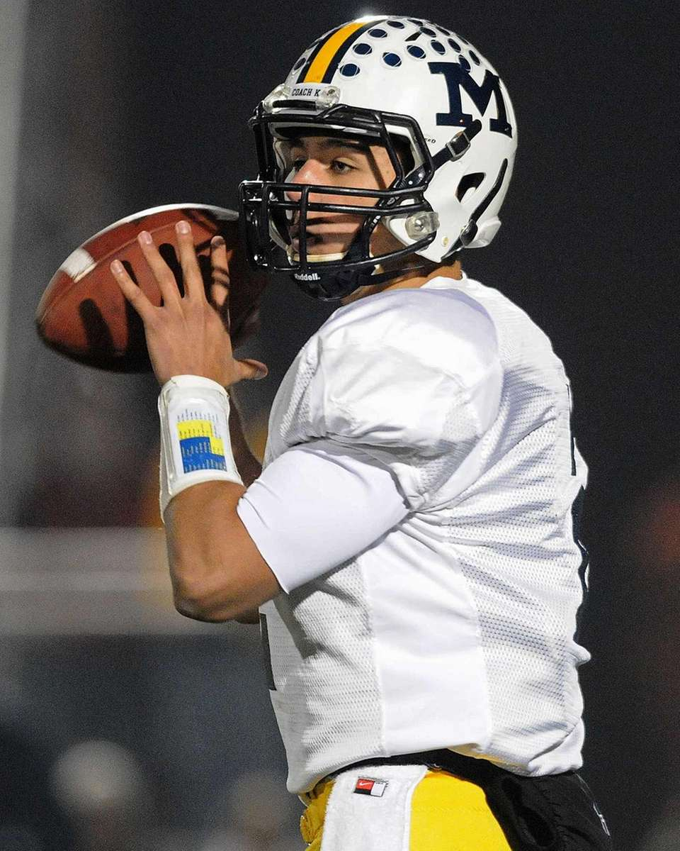 Massapequa quarterback Matt Caracappa looks for an open