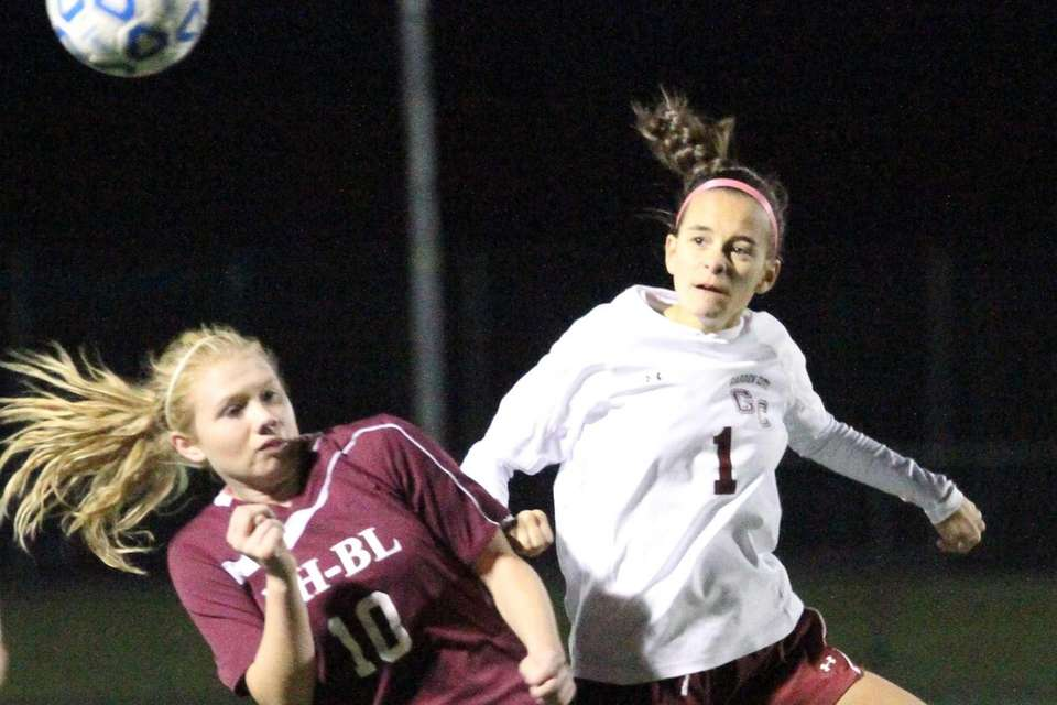 Garden City's Samantha Miesemer heads the ball over