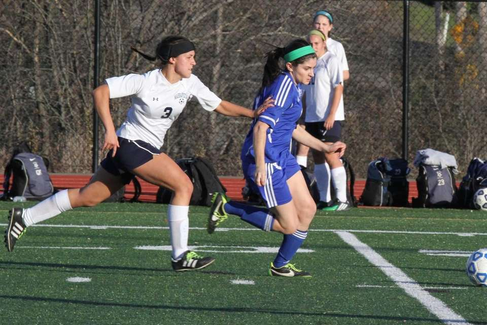 Massapequa's Olivia Stegner grabs Stephanie Liberati of CNS's