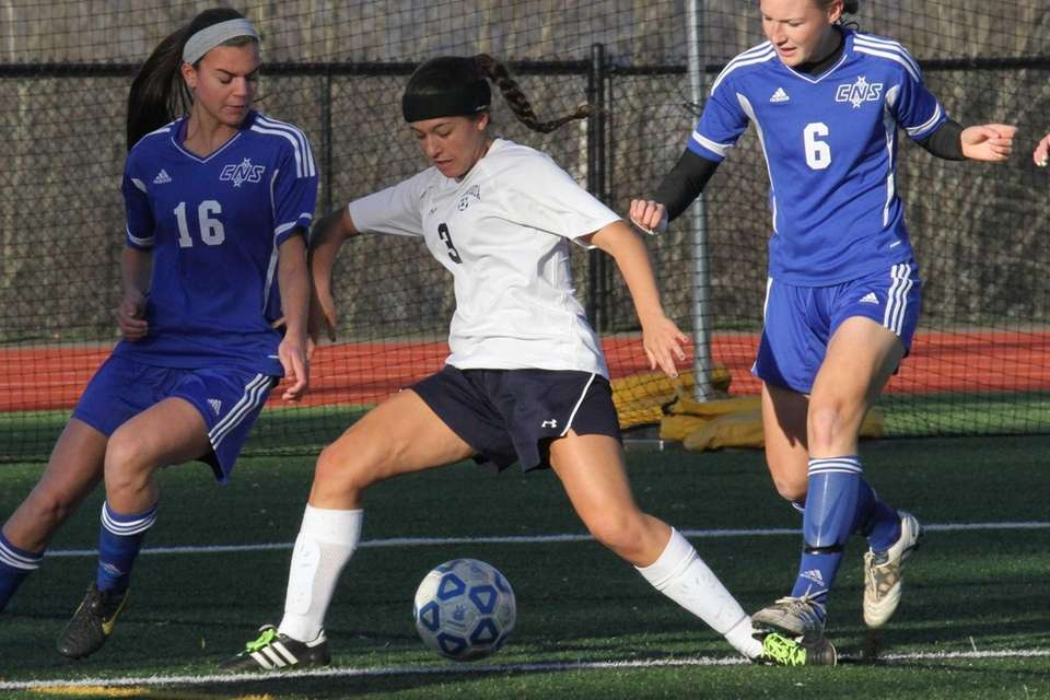 Massapequa's Karen Boronczyk fights for the ball against