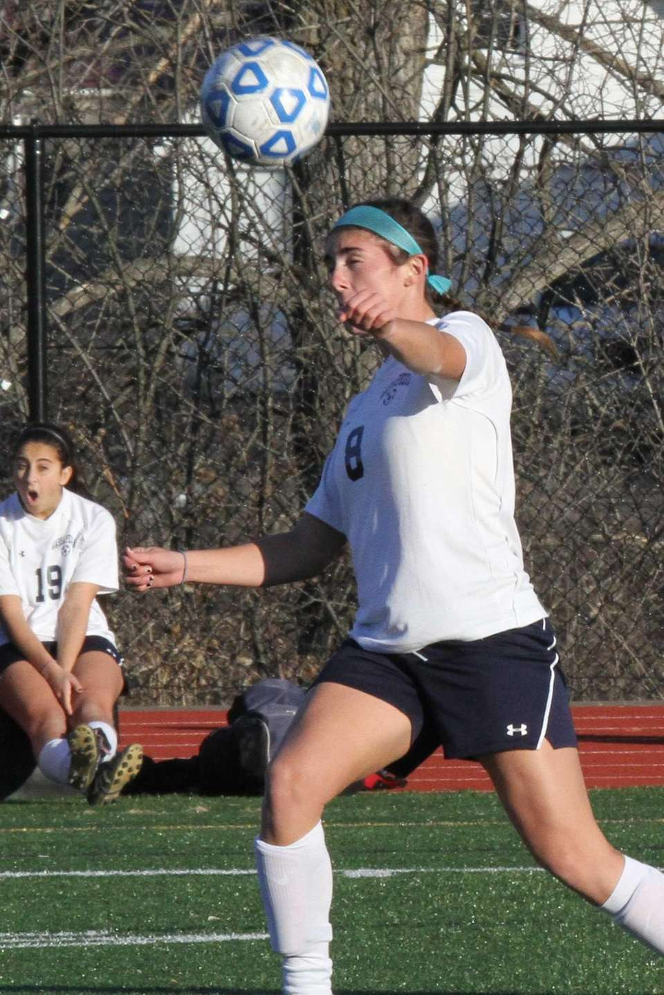 Massapequa's Alyssa Iannuzzi heads the ball against CNS.