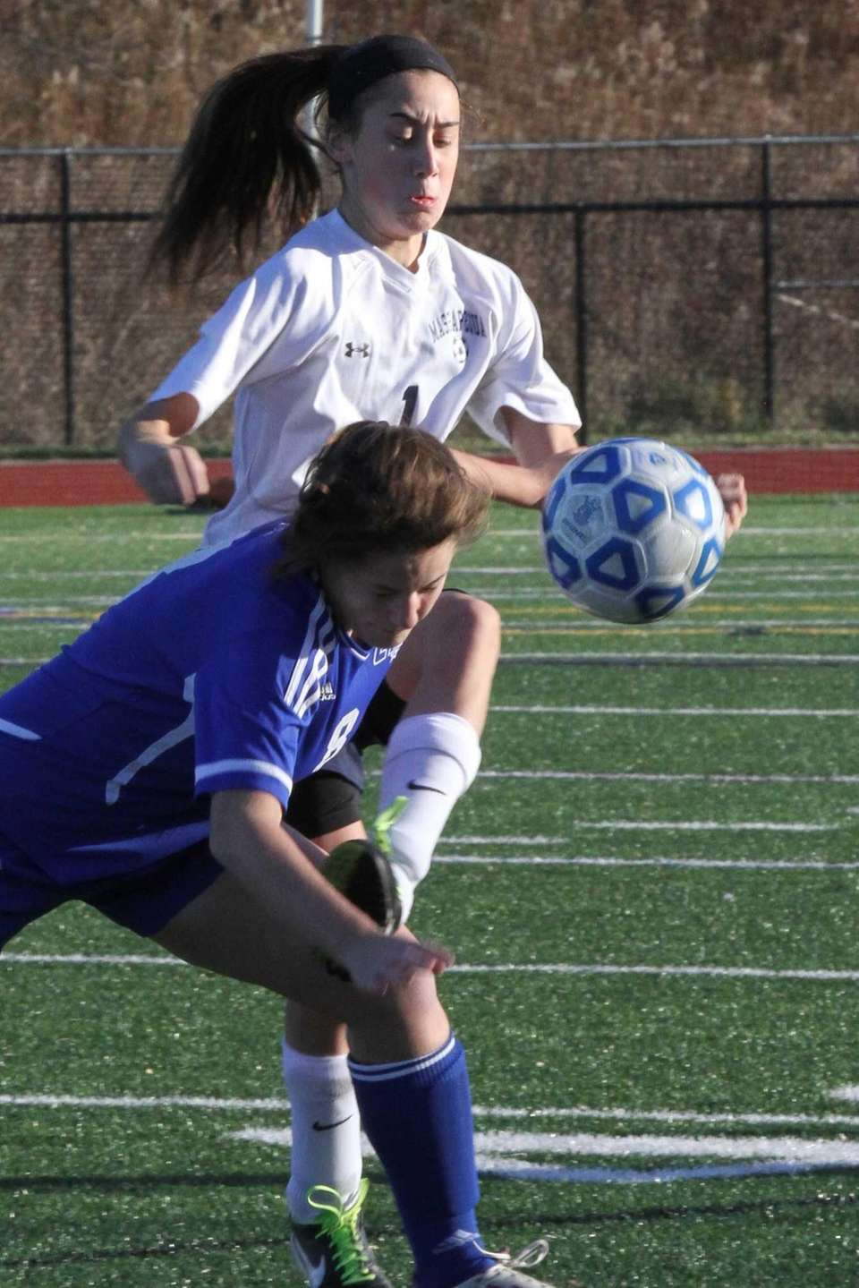 Massapequa's Hope Breslin fights for the ball against
