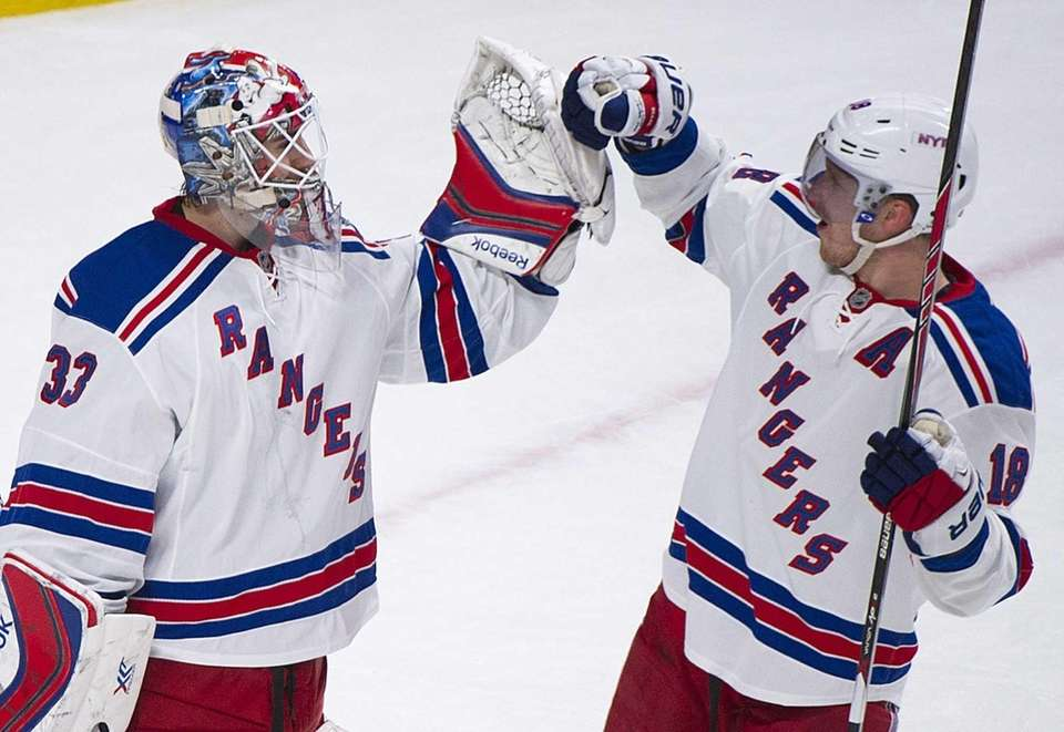 Rangers goaltender Cam Talbot, left, celebrates with Marc