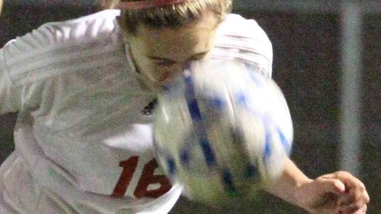 Center Moriches' Nicole Mangialardi heads the ball during