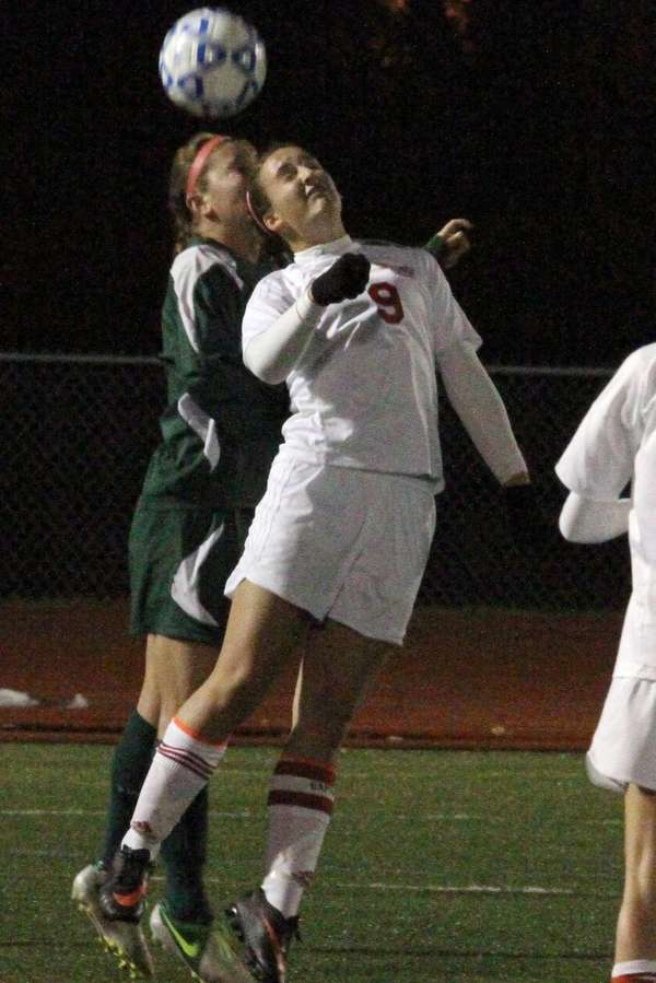 Center Moriches' Pam Schenck heads the ball during