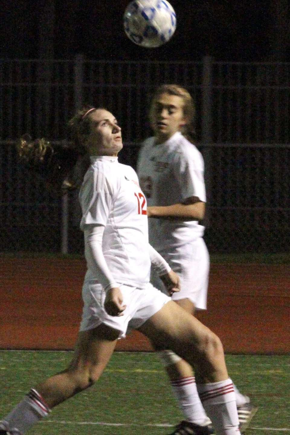 Center Moriches' Catherine Nolan heads the ball upfield