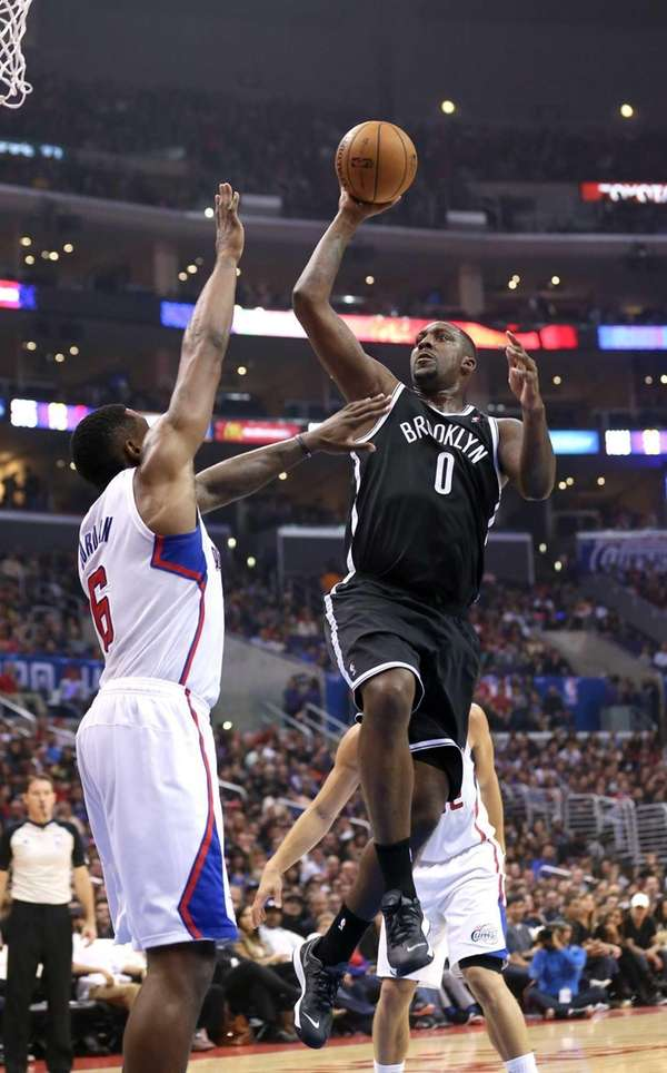 Andray Blatche of the Nets shoots over DeAndre
