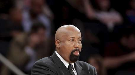 Knicks head coach Mike Woodson watches as the