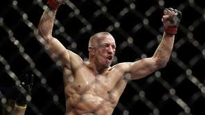 Georges St. Pierre left, reacts following his UFC