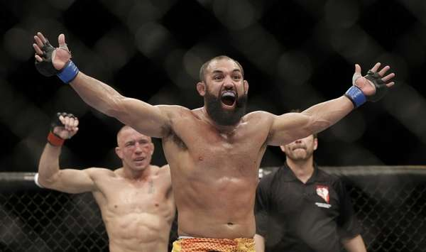 Johny Hendricks, center, reacts following a UFC 167