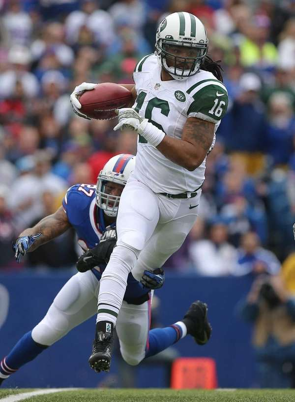 Josh Cribbs runs back a kick during a