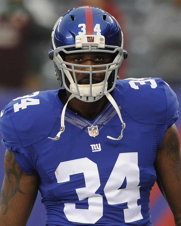 Brandon Jacobs looks on before a game against