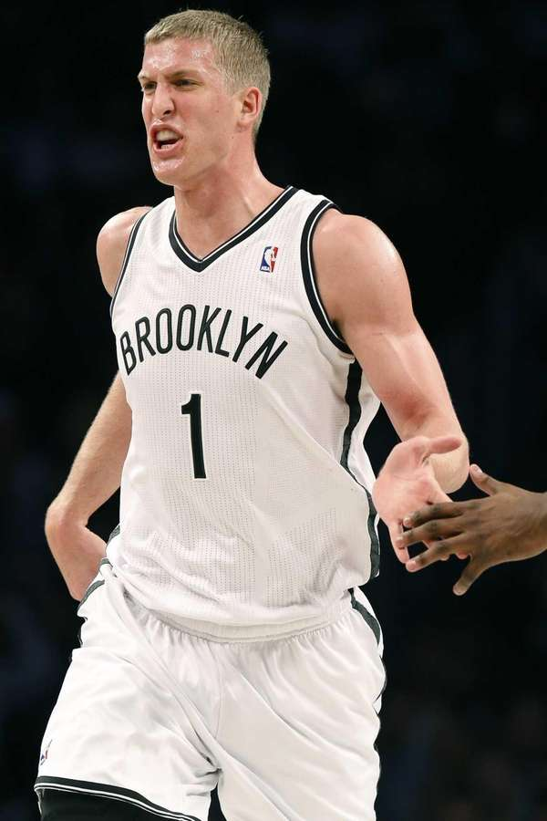 Mason Plumlee reacts after scoring during the second