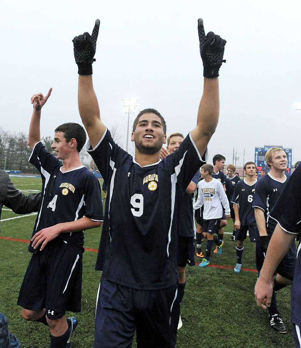 Massapequa's John Romano celebrates the team's championship win