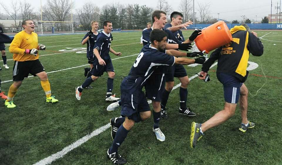 Massapequa's players attempt to douse head coach Keith