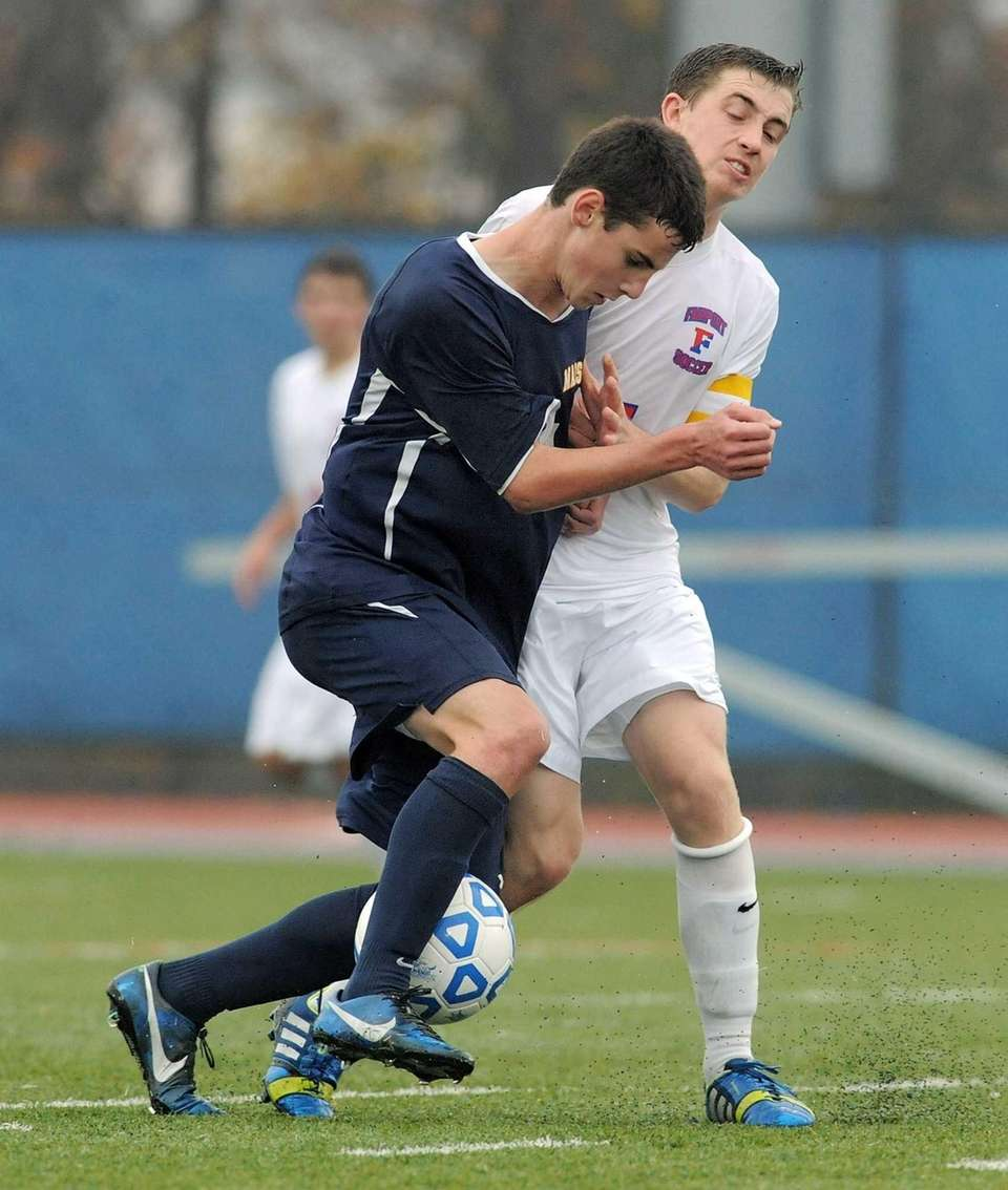 Massapequa's Dylan Nealis, left, collides with Fairport's Matt