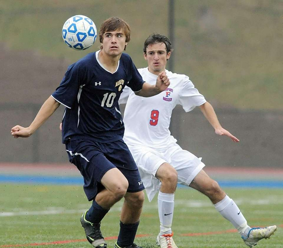 Massapequa's Brian Nichtern, left, settles the ball in
