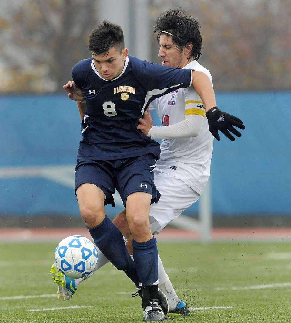 Massapequa's Brendan Gallivan, left, is tripped up by