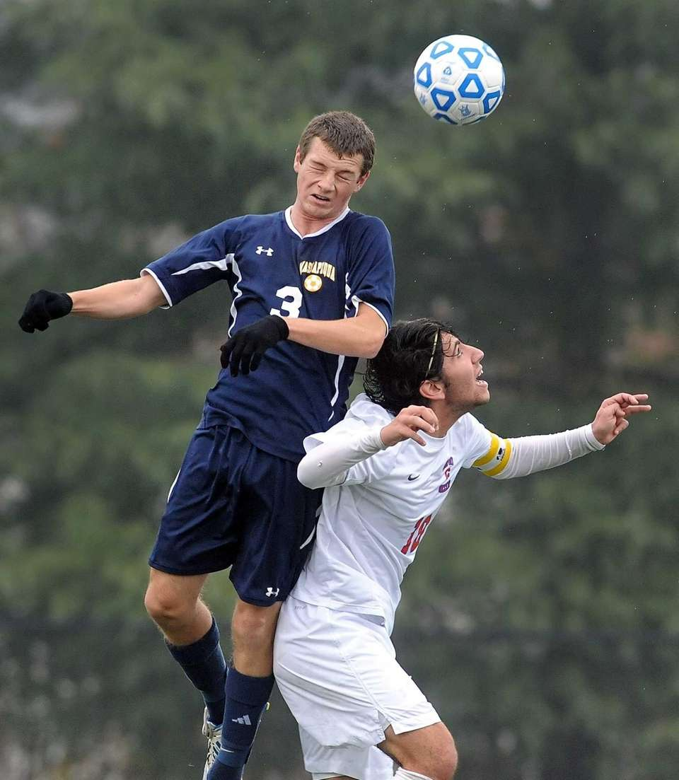 Massapequa's Brandon Merklin, top, wins a header over
