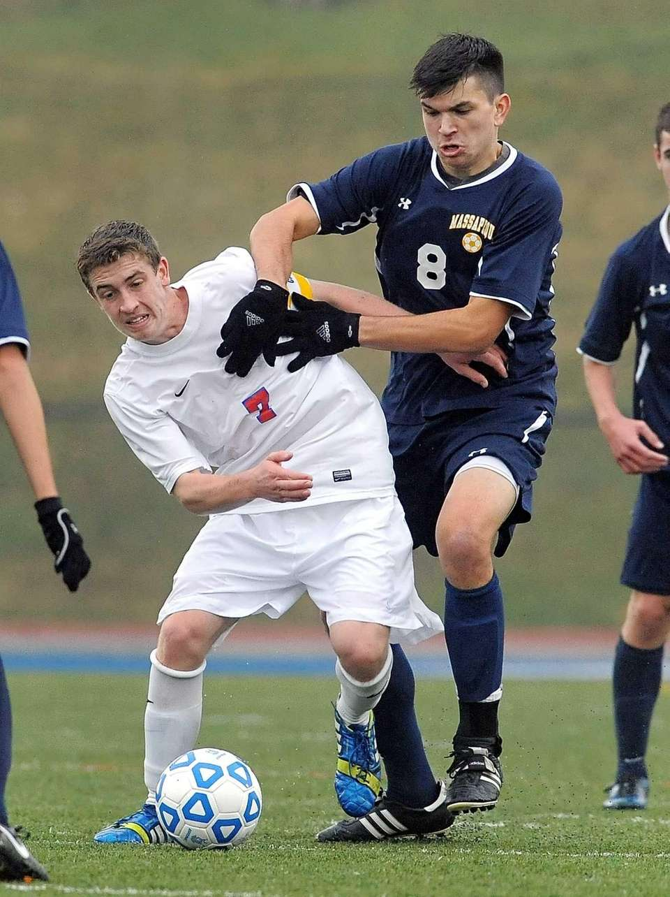 Massapequa's Brendan Gallivan, right, tries to get the