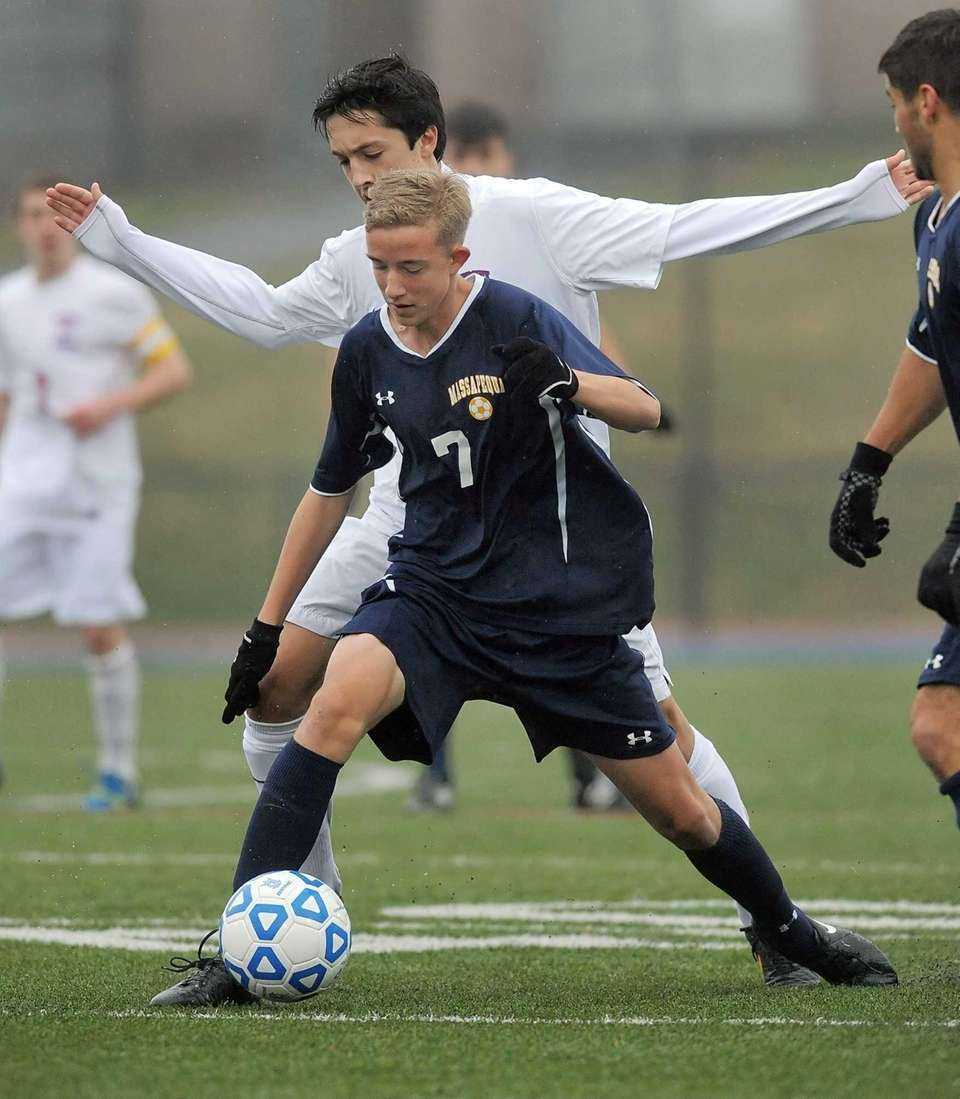 Massapequa's Brendan Raab, front, shields the ball from