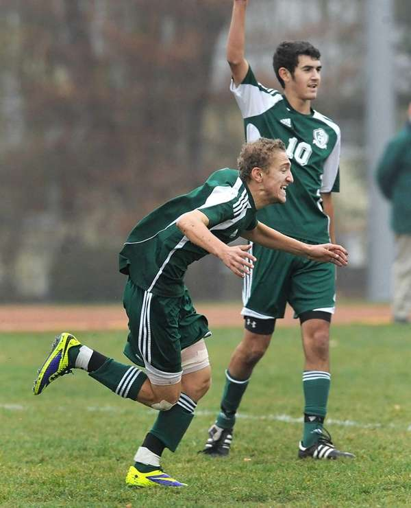 Carle Place's Dylan Klein, left, celebrates his goal