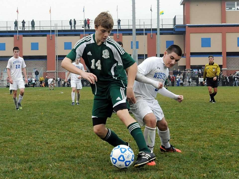 Carle Place's Patrick Browne, left, turns the ball