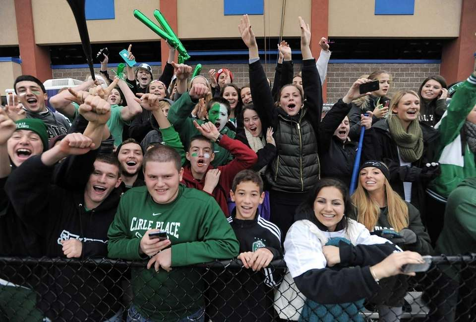 Carle Place fans celebrate their team's championship victory.