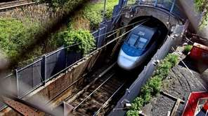 An Amtrak train disappears into a tunnel in
