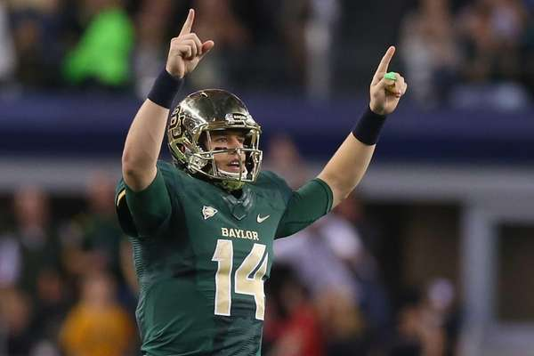 Baylor quarterback Bryce Petty celebrates a touchdown against