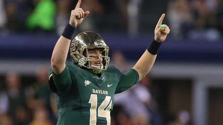 Baylor quarterback Bryce Petty celebrates a touchdown against