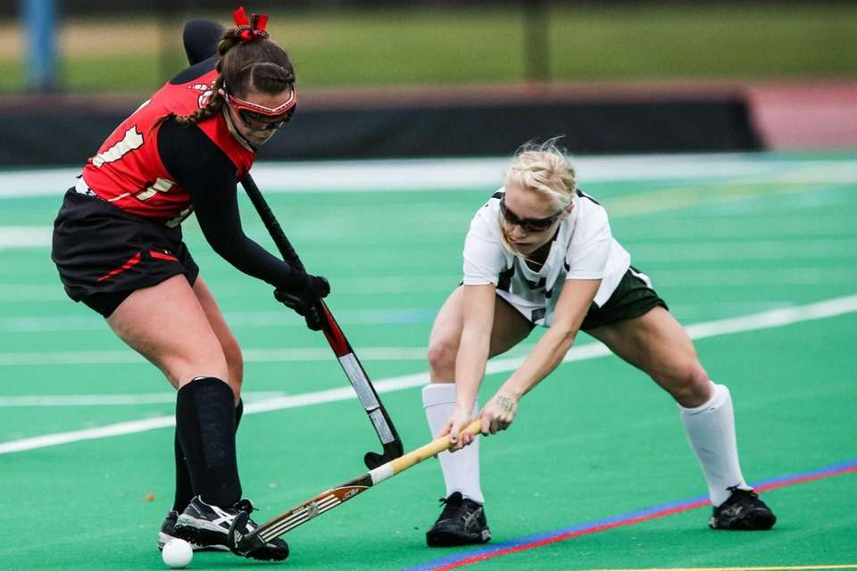Sachem East's Kelly Mckeveny (11) and Shenendehowa's Caroline