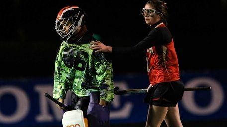 Sachem East's Katie Trombetta (1) supports fellow teammate
