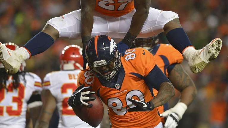 Denver Broncos running back Knowshon Moreno leaps over