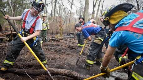 Firefighters from the Baldwin Fire Department dig up
