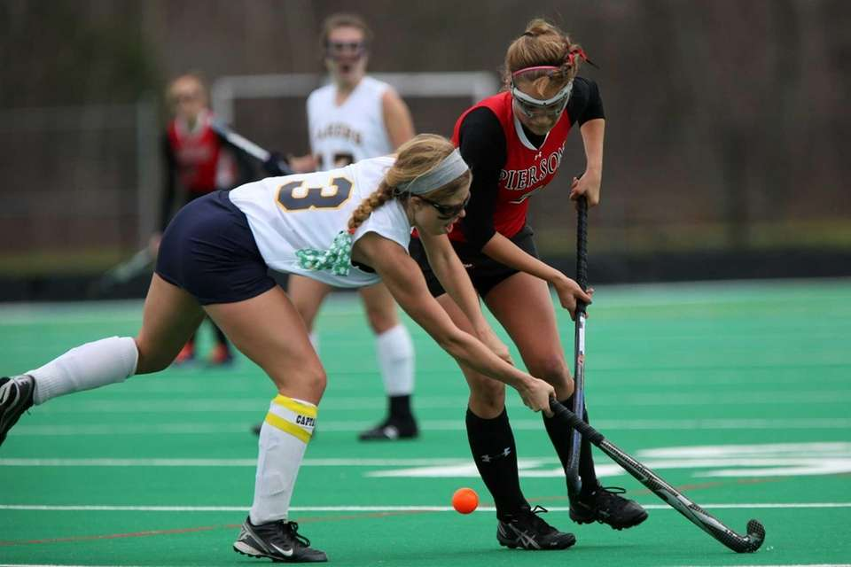 Pierson-Bridgehampton's Erica Selyukova moves the ball away from