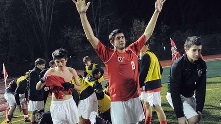 Friends Academy's Patrick Moodhe, center, celebrates the championship