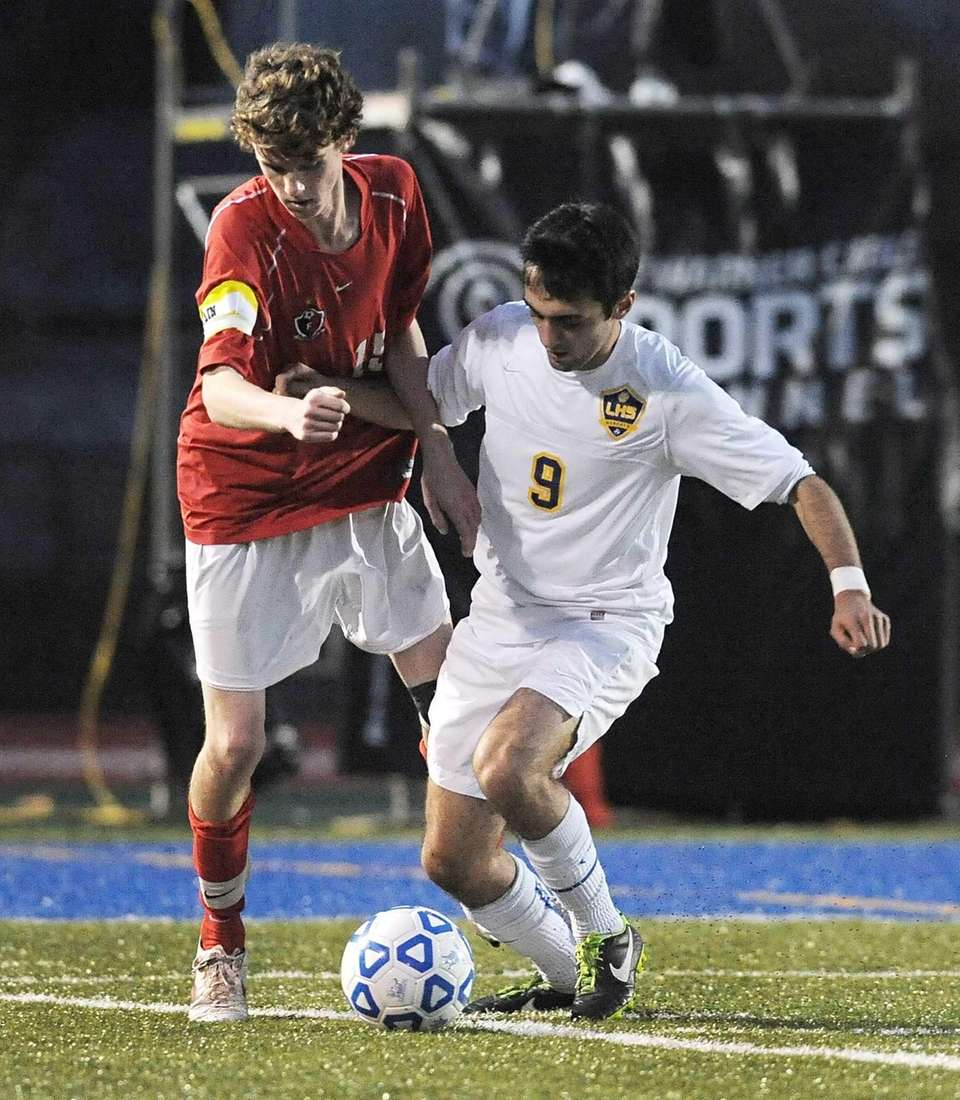 Friends Academy's Andrew Stingi, left, challenges for the